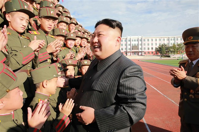 This undated photo released by North Korea's official Korean Central News Agency (KCNA) on October 13, 2017, shows North Korean leader Kim Jong Un (C) photographed with students and teachers of Mangyongdae Revolutionary School in Pyongyang on its 70th founding anniversary.