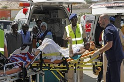 Turkish doctors transport a critically wounded man on a stretcher to a waiting Turkish air ambulance in Mogadishu, Somalia, on Oct,16, 2017, to airlift injured patients for treatment in Turkey.
