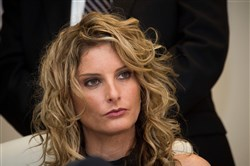 This file photo taken January 17, 2017, shows Summer Zervos attending a press conference with her attorney Gloria Allred (not seen) to announce the filing of a lawsuit against then-President-elect Donald Trump in Los Angeles.