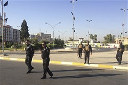 "Local police are deployed in Kirkuk, 290 kilometers (180 miles) north of Baghdad, Iraq, Monday, Oct. 16, 2017.  Iraqi Kurdish officials said early Monday that federal forces and state-backed militias have launched a ""major, multi-pronged"" attack aimed at retaking the disputed northern city of Kirkuk, causing ""lots of casualties"" in fighting south of the city.  (AP Photo/Emad Matti)"
