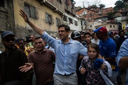 Carlos Ocariz, candidate for governor of Miranda State (center) waves to supporters while on the way to a relocated polling station ahead of state governors elections in Caracas, Venezuela, on Oct. 15, 2017. MUST CREDIT: Bloomberg photo by Wil Riera.