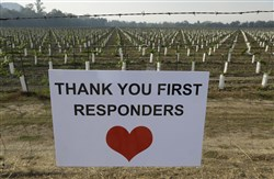 A sign thanking first responders hangs by a newly planted vineyard Oct. 16, 2017, in Napa, Calif.