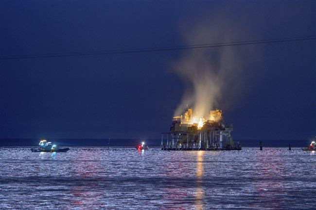 Jefferson Parish, La., authorities and others from other parishes respond to an oil rig explosion in Lake Pontchartrain off Kenner, La., on Oct. 15, 2017.
