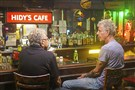 "Anthony Bourdain has a drink with local filmmaker Tony Buba at Hidy's Cafe in Braddock while filming the Pittsburgh episode of the CNN show ""Parts Unknown."""