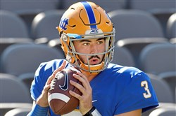 Pitt quarterback Ben DiNucci warms up before his team takes on N.C. State Saturday, October 14, 2017 at Heinz Field.