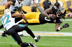 Martavis Bryant pulls in a pass around the Jaguars' Aaron Colvin in the second quarter Oct. 8 at Heinz Field.