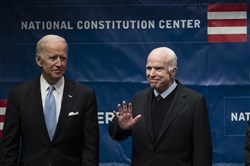 Sen. John McCain, R-Ariz., right, accompanied by Chair of the National Constitution Center's Board of Trustees, former Vice President Joe Biden, waves as he takes the stage before receiving the Liberty Medal in Philadelphia, Monday, Oct. 16, 2017. The honor is given annually to an individual who displays courage and conviction while striving to secure liberty for people worldwide.