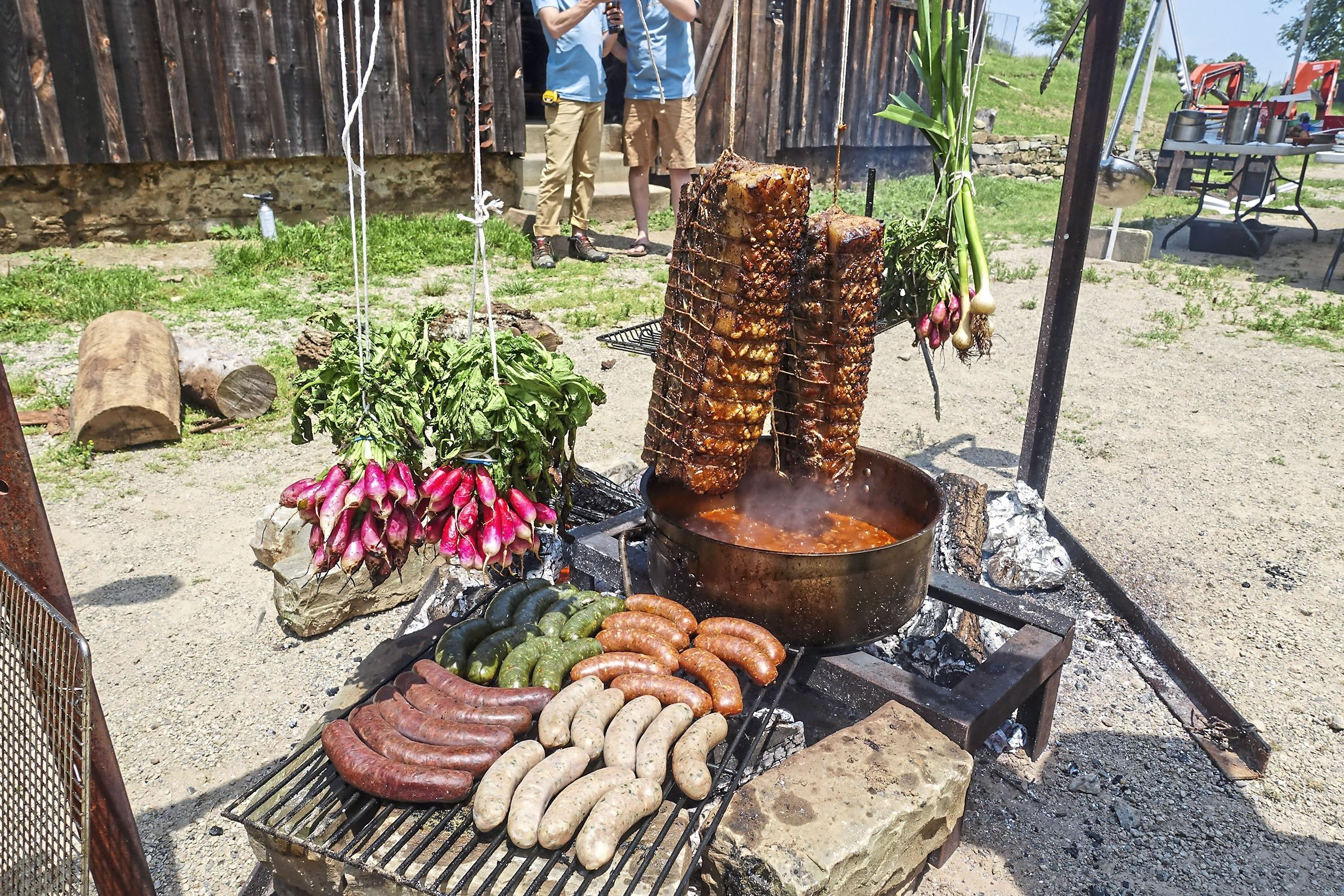 """bourdain pittsburgh white oak-4  A spread of smoked meats and vegetables is prepared for a private dinner at White Oak Farm in Hampton for a segment of Anthony Bourdain's CNN show, """"Parts Unknown."""""""