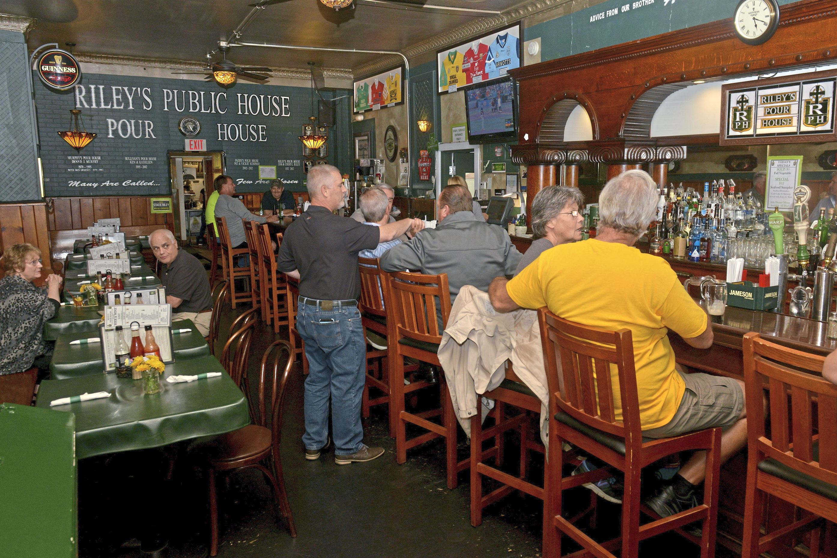 20171006ppRileys1DISTINCTION Patrons at Riley's Public Pour House enjoy happy hour at the Carnegie bar on an October Friday.