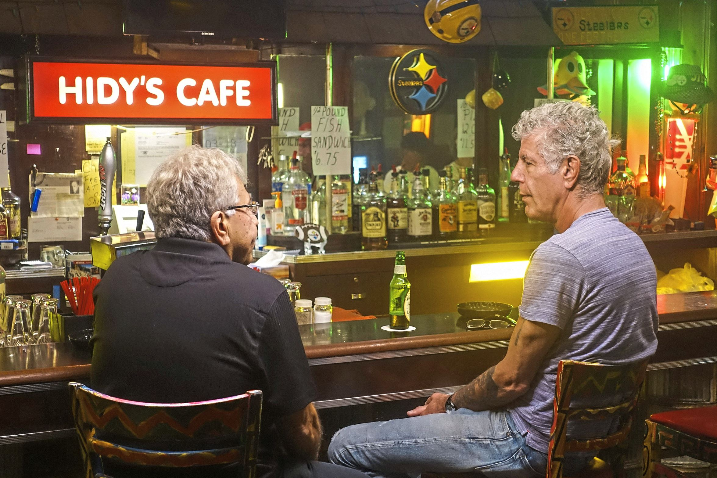 """bourdain pittsburgh buba-1 Anthony Bourdain has a drink with local filmmaker Tony Buba at Hidy's Cafe in Braddock while filming the Pittsburgh episode of the CNN show """"Parts Unknown."""""""