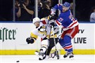Ryan McDonagh #27 of the New York Rangers checks Phil Kessel #81 of the Pittsburgh Penguins during the second period at Madison Square Garden on October 17, 2017 in New York City.