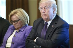 President Donald Trump, right, sitting next to Sen. Claire McCaskill, D-Mo., left, speaks during a meeting with members of the Senate Finance Committee and members of the president's economic team in the Cabinet Room of the White House in Washington on Oct. 18, 2017.