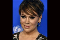 In this Jan. 12, 2016, file photo, Alyssa Milano arrives at the Sixth Biennial UNICEF Ball in Beverly Hills, Calif.