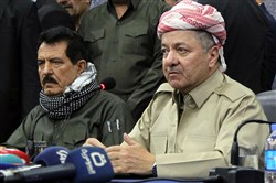A file picture taken September 12, 2017, shows Iraq's Kurdistan region president Massud Barzani (R) attending an assembly with Kosrat Rasoul Ali (L), the first Deputy for the Secretary General of the Patriotic Union of Kurdistan (PUK) party, and other representatives of the peshmerga and Arab, Kurdish, and Iraqi Turkmen tribal leaders in the northern Iraqi city of Kirkuk.