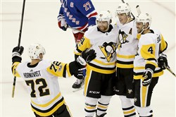 Evgeni Malkin and his teammates celebrate after Malkin's overtime game-winner.