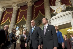 U.S. Sens. Bob Casey, D-Pa., left, and Pat Toomey, R-Pa., walk together in 2013 as they arrive for the State of the Union address at the Capitol Building in Washington, D.C.  The two are scheduled to meet with President Donald Trump to discuss the GOP's latest tax plan.