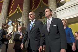 U.S. Senators Bob Casey, D-Pa., left, and Pat Toomey, R-Pa., walk together as they arrive for the State of the Union address Tuesday, February 12, 2013, at the U.S. Capitol in Washington, D.C.
