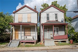 Houses on Fletcher Way in Homewood, part of the Bethesda-Homewood Properties, are either boarded up or in poor condition on Monday. More than 100 residents are being relocated due to poor housing conditions.