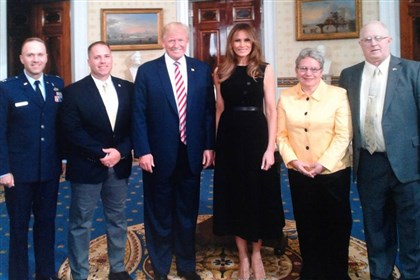 The family of fallen Marine Sgt. Joseph Caskey -- who was killed in Afghanistan in 2010 -- poses for a photo with President Donald Trump and First Lady Melania Trump at an event in June.
