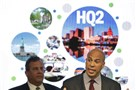 In this Monday, Oct. 16 file photo, New Jersey Sen. Cory Booker, right, speaks while New Jersey Gov. Chris Christie stands behind. The New Jersey lawmakers announced they are submitting a bid to Amazon that Newark would be the best location for the company's planned second headquarters.