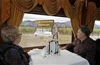 Gene Kuhn and his wife, Mary Ann of Omaha, Neb., look out at a welcome sign thanking first responders while riding the Napa Valley Wine Train on Oct. 19, 2017, in Oakville, Calif. The train resumed running this week after last week's wildfires.