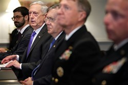Defense Secretary Jim Mattis (second left) before a lunch meeting with Israeli Defense Minister Avigdor Lieberman and other officials at the Pentagon on October 19, 2017, in Arlington, Virginia, answers reporters' questions about the American soldiers who were killed in Niger.