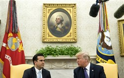 President Donald Trump speaks with Gov. Ricardo Rossello of Puerto Rico during a meeting in the Oval Office at the White House on October 19, 2017, in Washington.