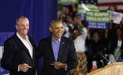 Former U.S. President Barack Obama stands on stage with Democratic candidate Phil Murphy during his campaign for governor of New Jersey.