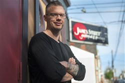 Manager Kevin Saftner stands for a portrait outside of James Street Gastropub and Speakeasy. He said the North Side restaurant, bar and music venue will be closing after continued complaints from a few neighbors about the noise.