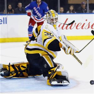 Matt Murray makes a kick save in the second period of the Penguins' game against the New York Rangers on Tuesday at Madison Square Garden.