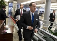 Sen. Pat Toomey, R-Pa., a member of the Senate Budget Committee, heads to the floor during a series of votes at the Capitol in Washington, Thursday.