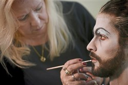 Sherry Deberson, a theater makeup artist and hair stylist for Pittsburgh Ballet Theatre, transforms principal dancer Alejandro Diaz into Dracula.