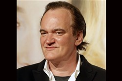 In this Oct. 8, 2016, file photo, director Quentin Tarantino poses for photographers at the opening ceremony of the 8th Lumiere Festival, in Lyon, central France.