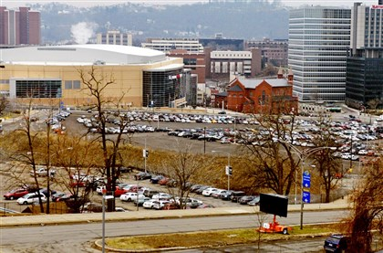 The developer had hoped to begin construction of the first 255 units, 20 percent of which will be affordable to households earning 60 percent or less of the area median income, this fall. The new PPG Paints Arena is pictured at left.
