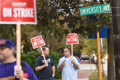 West Chester University professors carry picket signs as they and other faculty in the Pennsylvania State System of Higher Education went on strike last year.