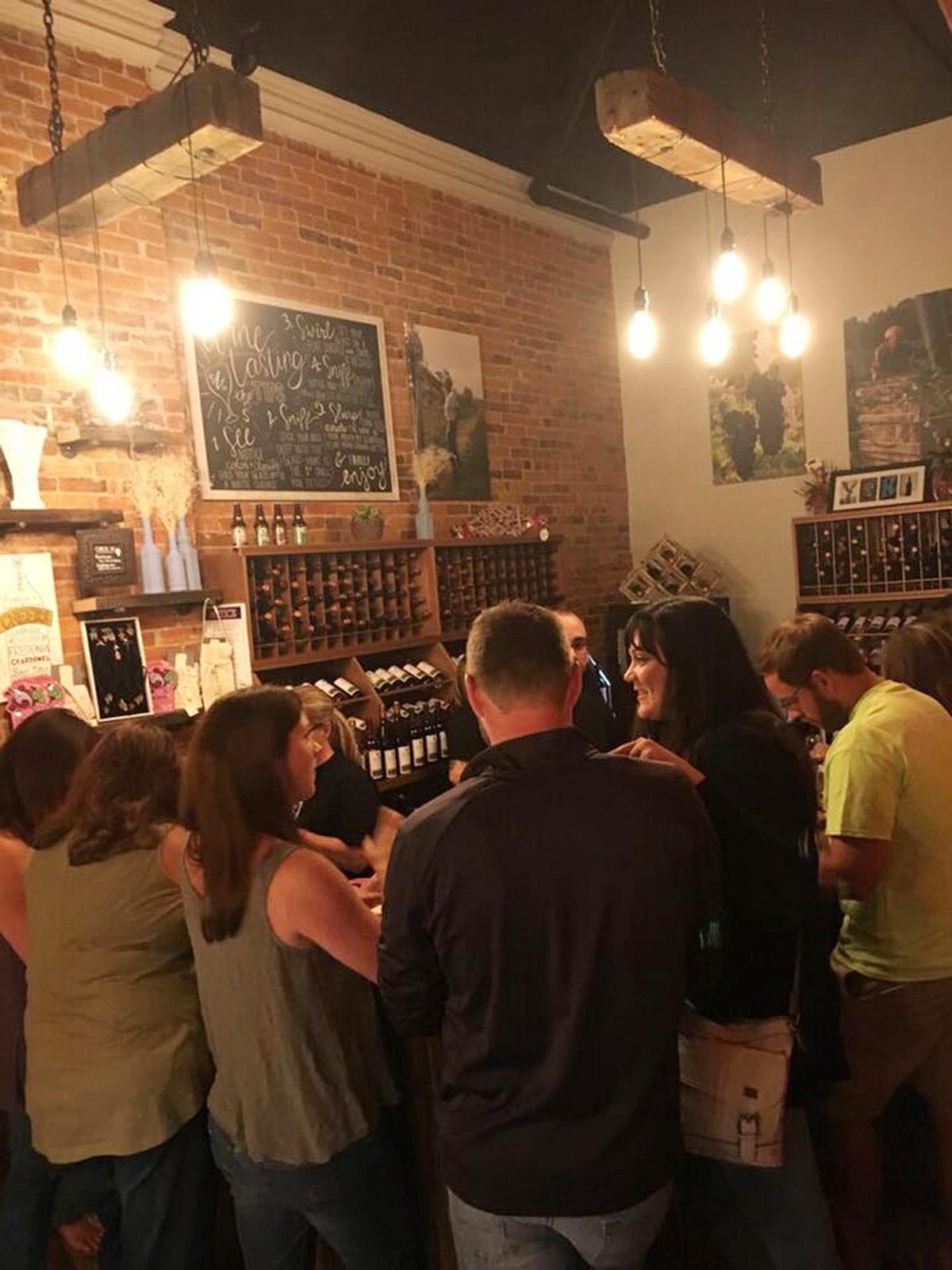 yori3-1 Customers in the tasting room of Yori Wine Cellars in North East, Pa.