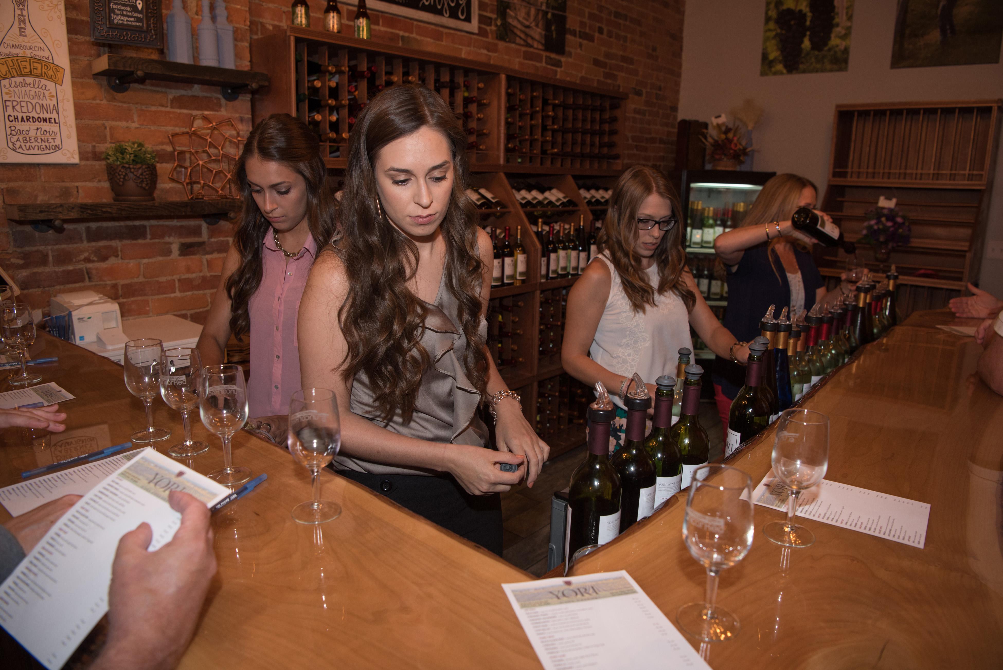 yori6 Mikaela, far left, Kariann, Allison and Lynn Yori serve samples during grand opening weekend at Yori Wine Cellars in North East, Pa.