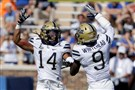 Pitt cornerback Avonte Maddox, left, high-fives safety Jordan Whitehead in the Panthers' 24-17 win Saturday at Duke, but Maddox left the game early with an injury and didn't return.