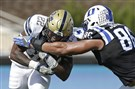 Duke's Drew Jordan reaches for Pittsburgh's Darrin Hall during the first half of an NCAA college football game in Durham, N.C., Saturday, Oct. 21, 2017.