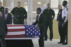 The casket of Sgt. La David T. Johnson of Miami Gardens, who was killed in an ambush in Niger. is wheeled out after a viewing at the Christ The Rock Church, Friday, Oct. 20, 2017  in Cooper City, Fla.