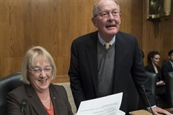 Sen. Patty Murray, D-Wash., the ranking member, and Sen. Lamar Alexander, R-Tenn., chairman of the Senate Health, Education, Labor, and Pensions Committee, meet Wednesday before the start of a hearing on Capitol Hill.