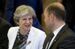 British Prime Minister Theresa May speaks with Malta's Prime Minister Joseph Muscat at an EU summit Friday in Brussels.