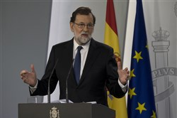 Spain's Prime Minister Mariano Rajoy speaks during a news conference at the Moncloa Palace in Madrid, Spain, Saturday, Oct. 21, 2017.