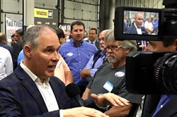 In this Oct. 9, 2017, file photo, EPA Administrator Scott Pruitt talks to a reporter after speaking at Whayne Supply in Hazard, Ky.