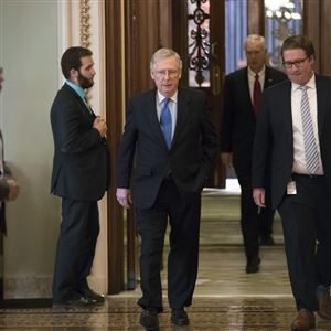 In this Oct. 19, 2017, file photo, Senate Majority Leader Mitch McConnell, R-Ky., walks from the chamber to his office during a long series of votes at the Capitol in Washington.