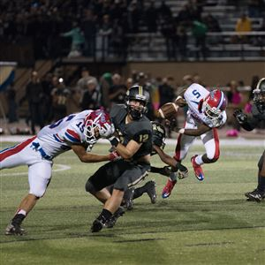 McKeesport running back John Harper fumbles the ball at Gateway Senior High School on Friday.