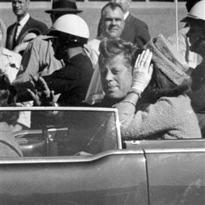 In this Nov. 22, 1963 file photo, President John F. Kennedy waves from his car in a motorcade in Dallas. Riding with Kennedy are First Lady Jacqueline Kennedy, right, Nellie Connally, second from left, and her husband, Texas Gov. John Connally, far left.