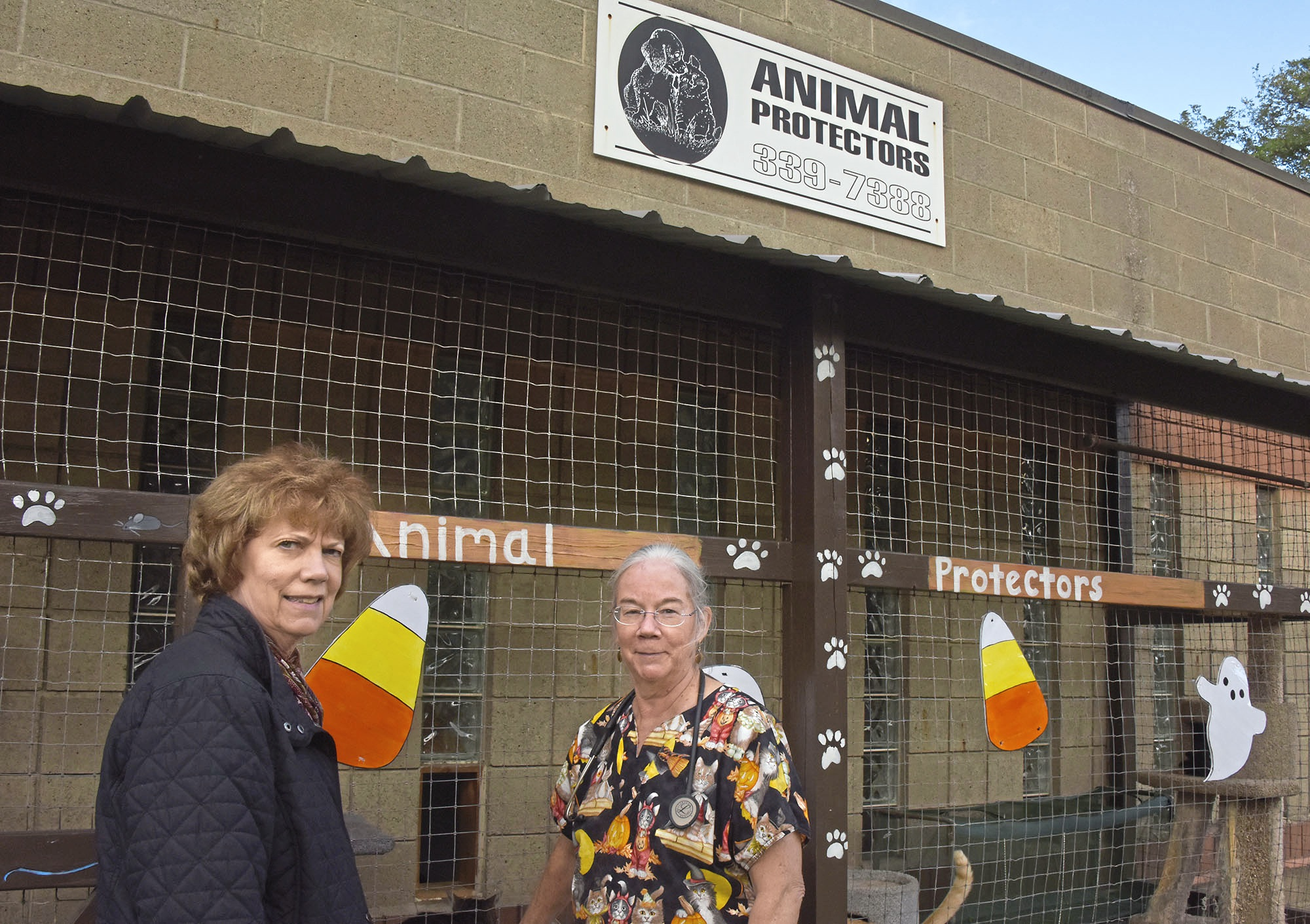20171016dsPetTales1021Mag01 Phyllis Framel, president of the board at Animal Protectors of Allegheny Valley, and Betsy Kennon stand in front of the Animal Protectors Of Allegheny Valley's current shelter.
