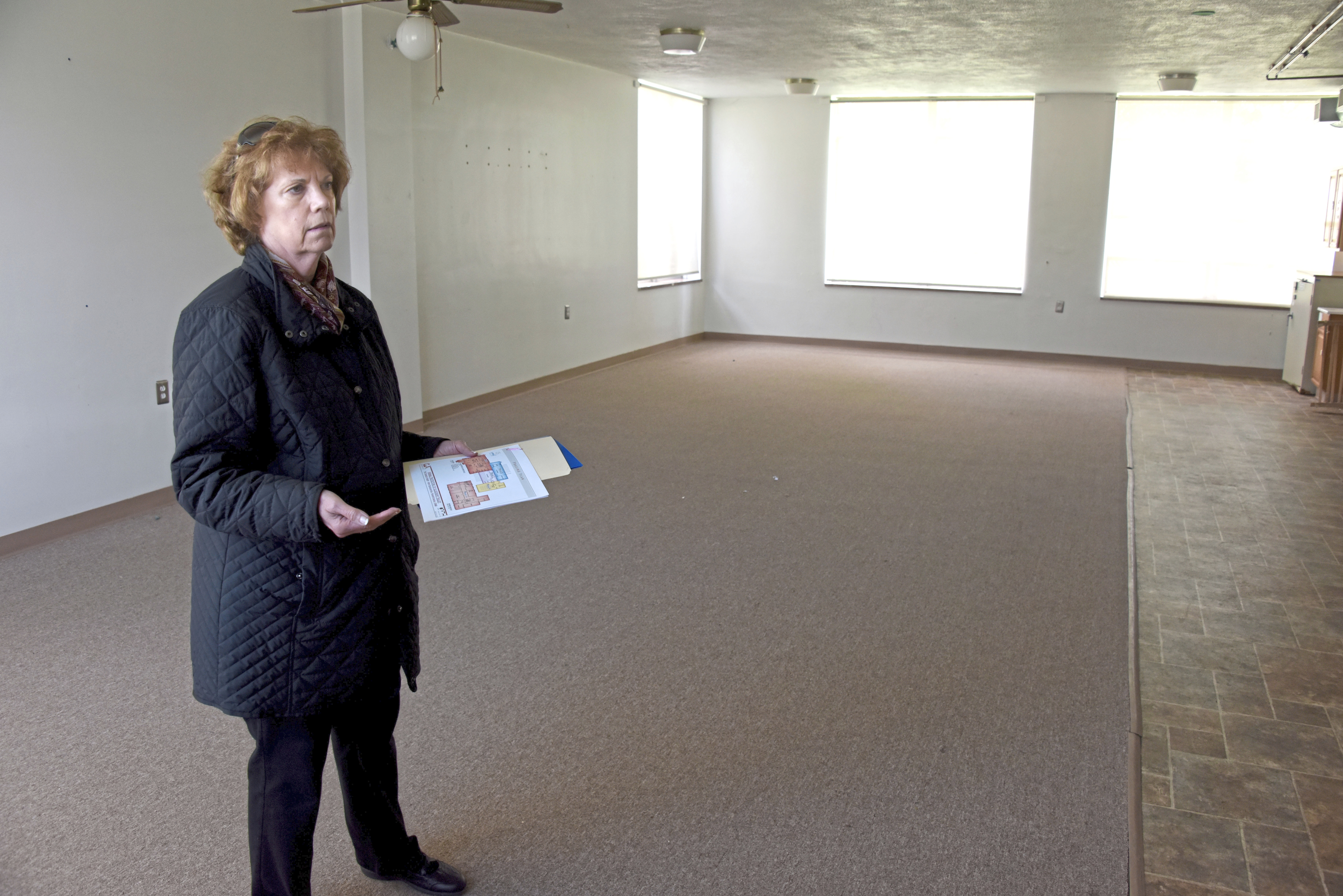 20171016dsPetTales1021Mag08-7 Phyllis Framel stands in a room at a closed elementary school that will be used as a kennel for the Animal Protectors Of Allegheny Valley's new shelter.