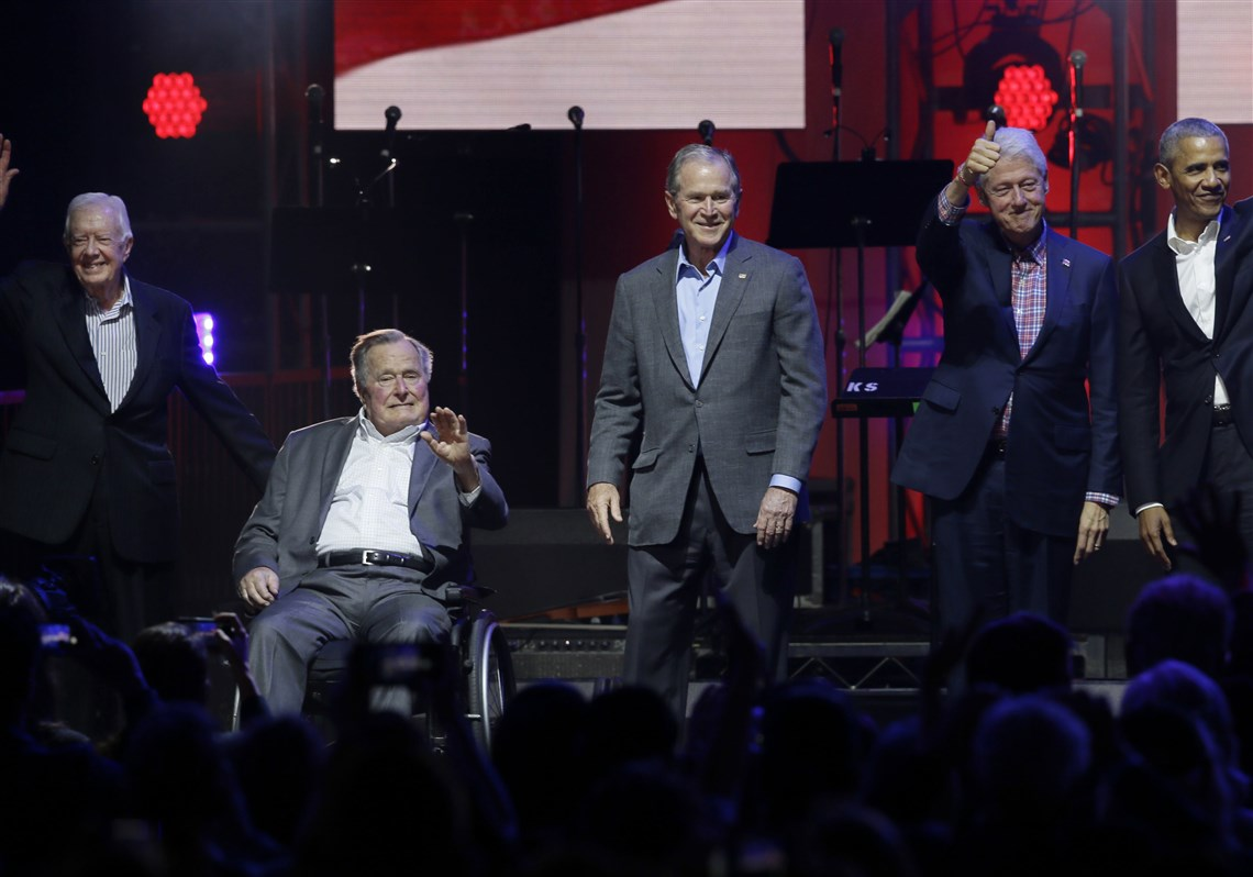 Former presidents from right: Barack Obama, Bill Clinton, George W. Bush, George H.W. Bush and Jimmy Carter gather on stage at the opening of a hurricanes relief concert in College Station, Texas, Saturday, Oct. 21, 2017.